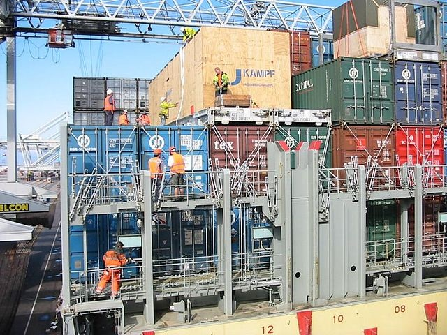 A team of dockworkers at work on a container ship in Rotterdam